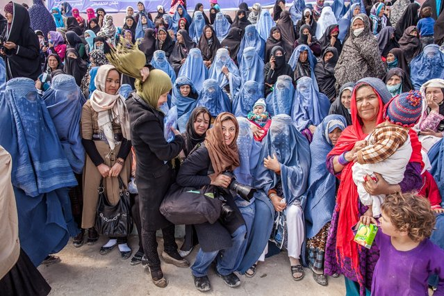 Photojournalist Lynsey Addario shooting the presidential election in Afghanistan in 2014. (Photo by Bryan Denton)