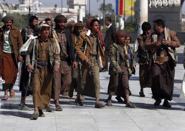 Armed Houthi fighters gather during a funeral procession for slain Houthi fighters in Sana?a, Yemen, 28 February 2021. The Houthi military spokesman, Yahya Sarea, has threatened more attacks against Saudi Arabia, which leads a military coalition involved in the escalating conflict in Yemen, a day after the Houthis carried out attacks with 15 drones and a ballistic missile against the Saudi capital Riyadh and the south of the kingdom. (Photo by Yahya Arhab/EPA/EFE)