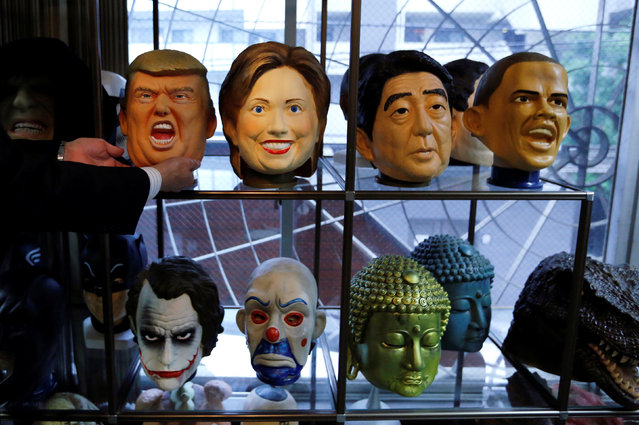Rubber masks depicting U.S. President-elect Donald Trump (top L), Hillary Clinton (top 2nd L), Japan's Prime Minister Shinzo Abe and U.S. President Barack Obama (top R) are seen at the Ogawa Studios, a mask making company, in Saitama, Japan, November 21, 2016. (Photo by Toru Hanai/Reuters)
