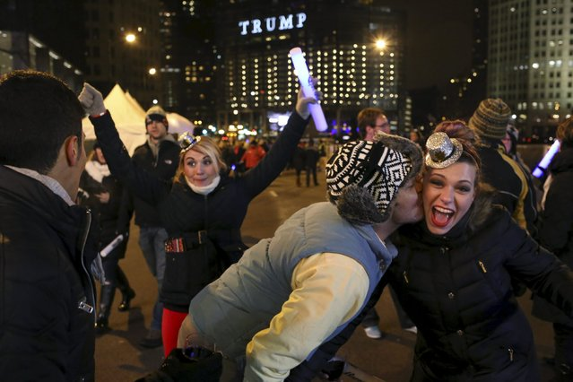 People celebrate before the New Year at Chi-Town Rising in Chicago, Illinois, December 31, 2015. (Photo by Alex Wroblewski/Reuters)