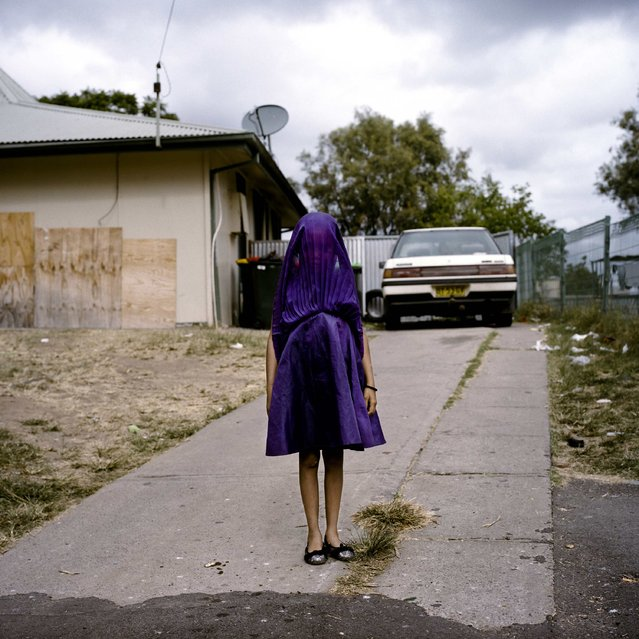 Raphaela Rosella, an Australian photographer of Oculi agency, won the First Prize in the Portraits Category, Singles, of the 2015 World Press Photo contest with this portrait of Laurinda waiting in her purple dress for the bus that will take her to Sunday school in Moree, New South Wales, Australia, in this picture released by the World Press Photo organisation on February 12, 2015. (Photo by Raphaela Rosella/Reuters/Oculi/World Press Photo)