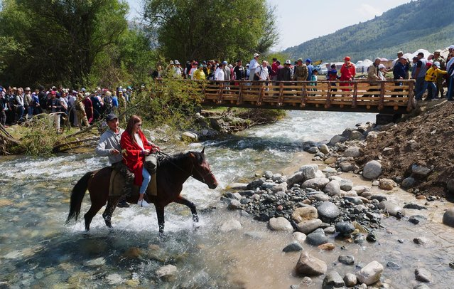 Young locals take the low road as their horse clatters through a mountain stream on the way to the opening ceremony at Kyrchyn Gorge. (Photo by Amos Chapple/Radio Free Europe/Radio Liberty)