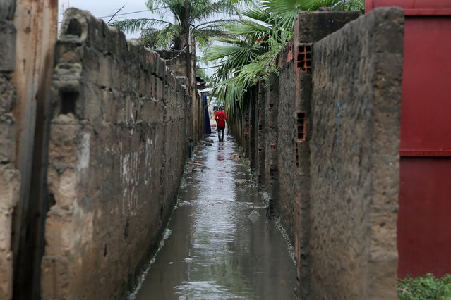 Flooded street in a Luanda neighborhood following the heavy rains that fell on 19 April that caused the death of 14 people and flooded more than 16,000 houses, Luanda, Angola, 20 April 2021. (Photo by Ampe Rogerio/EPA/EFE)