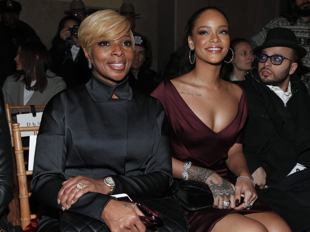 Mary J. Blige, left, and Rihanna attend the Zac Posen Fall 2015 show during Mercedes-Benz Fashion Week Fall 2015 at Grand Central Terminal on Monday, February 16, 2015, in New York. (Photo by Andy Kropa/Invision/AP Photo)