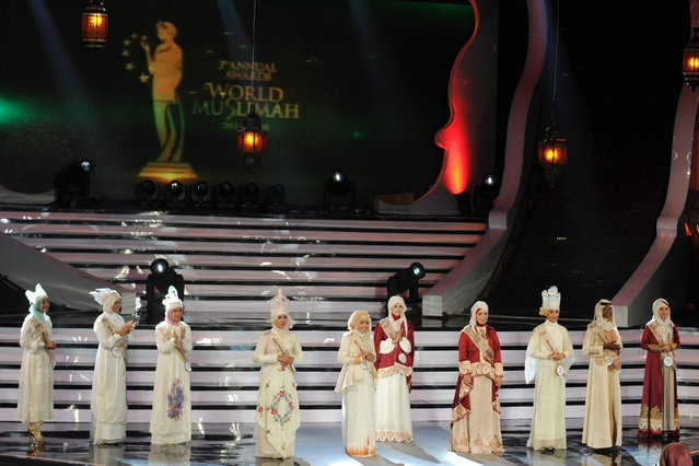 The ten final contestants of the Muslimah World 2013 answer questions from a judge panel during the Muslimah World competition in Jakarta on September 18, 2013. (Photo by Adek Berry/AFP Photo)