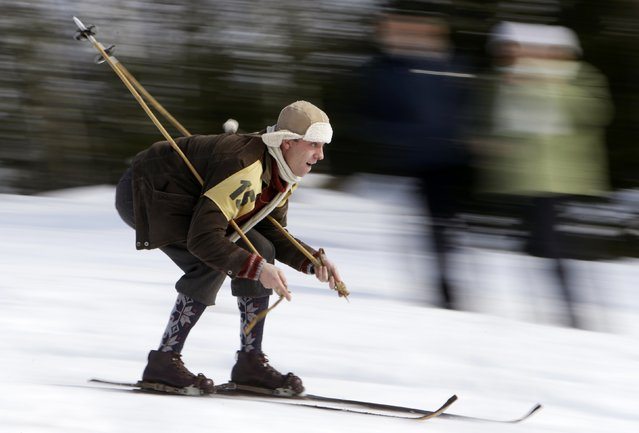 A participant competes on vintage skis during a traditional historical ski race in the northern Bohemian town of Smrzovka February 21, 2015. (Photo by David W. Cerny/Reuters)