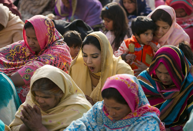 A Pakistani Christian woman yawns during the Christmas mass at a local church, Friday, December 25, 2015 in Islamabad, Pakistan. (Photo by B.K. Bangash/AP Photo)