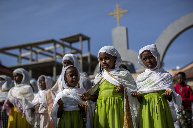 Children and other congregants pray during a Sunday morning service of the Ethiopian Orthodox Tewahedo Church at the Church of St. Mary in Mekele, in the Tigray region of northern Ethiopia Sunday, May 9, 2021. The head of the Ethiopian Orthodox Church, Patriarch Abune Mathias, in a video shot last month on a mobile phone and carried out of Ethiopia, sharply criticized Ethiopia's actions in the conflict in the country's Tigray region. (Photo by Ben Curtis/AP Photo)