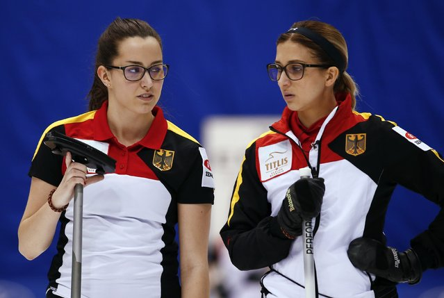 Germany's skip Daniela Driendl (R) and third Analena Jentsch talk between ends during their curling round robin game against the U.S. at the World Women's Curling Championship in Sapporo March 16, 2015. (Photo by Thomas Peter/Reuters)