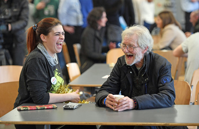 A volunteer has a laugh with a homeless visitor to a Crisis at Christmas centre, which is open over the festive period in London, UK on December 23, 2016. (Photo by Victoria Jones/PA Wire)