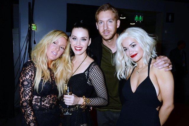 Ellie Goulding, Katy Perry, Calvin Harris and Rita Ora pose backstage. (Photo by Jeff Kravitz/FilmMagic)