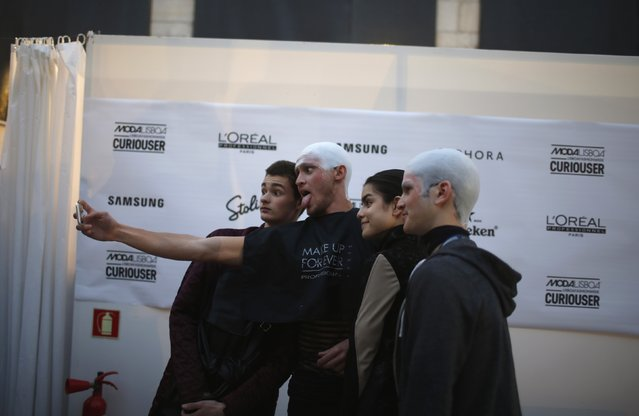 Models take a selfie backstage before the Ricardo Andrez Fall/Winter 2015 collection show during Lisbon Fashion Week March 13, 2015. (Photo by Rafael Marchante/Reuters)