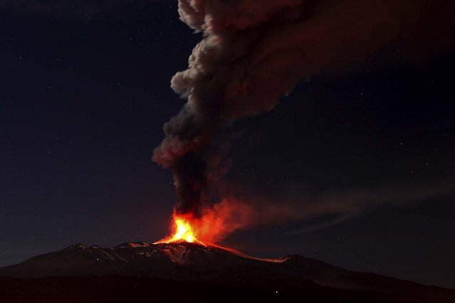 Mt. Etna spews lava during an eruption, seen from Acireale, near the Sicilian town of Catania. (Photo by Carmelo Imbesi/Associated Press)