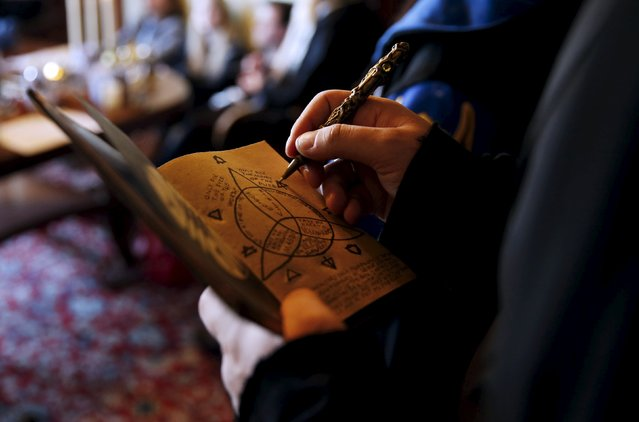 "A participant draws on his ""secret book"" during a workshop before the role play event at Czocha Castle in Sucha, west southern Poland April 9, 2015. (Photo by Kacper Pempel/Reuters)"