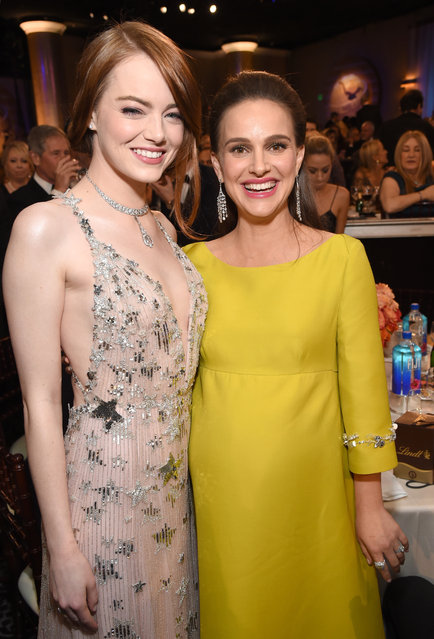 Actresses Emma Stone (L) and Natalie Portman attend the 74th Annual Golden Globe Awards at The Beverly Hilton Hotel on January 8, 2017 in Beverly Hills, California. (Photo by Michael Kovac/Getty Images)