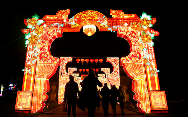 People are silhouetted against a light display during the The Magical Lantern Festival marking the Chinese new year at Chiswick House in London, Britain January 18, 2017. (Photo by Neil Hall/Reuters)
