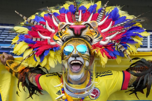 A fan of Colombia cheers prior to a qualifying soccer match between for the FIFA World Cup Qatar 2022 Colombia and Chile in Barranquilla, Colombia, Friday, September 10, 2021. (Photo by Fernando Vergara/AP Photo)