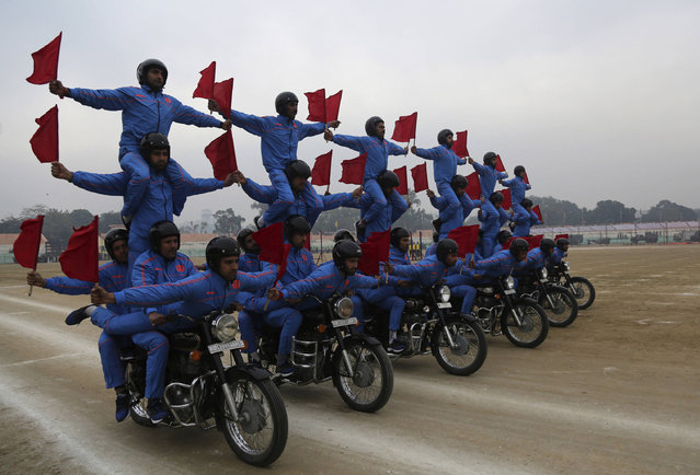 Indian policemen perform acrobatic skills on a motorcycle during rehearsals for the Republic Day parade in Jammu, India, Tuesday, January 24, 2017. India marks Republic Day on January 26 with military parades across the country. (Photo by Channi Anand/AP Photo)