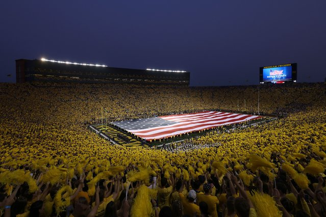 General view of Michigan Stadium before the game between the Washington Huskies and the Michigan Wolverines on September 11, 2021 in Ann Arbor, Michigan. Local first responders held up a flag during a tribute to the 20th anniversary of September 11th. (Photo by Gregory Shamus/Getty Images)