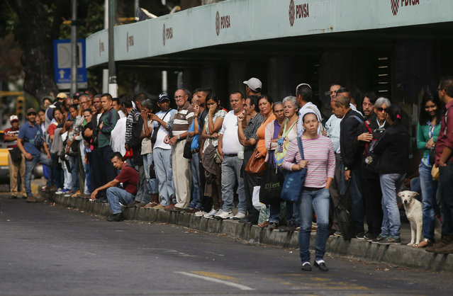 People wait for public transportation in Caracas, Venezuela, Friday, March 8, 2019. Much of Venezuela was still without electricity Friday amid the country's worst-ever power outage, raising tensions in a country already on edge from ongoing political turmoil. (Photo by Eduardo Verdugo/AP Photo)