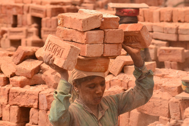 An Indian Women work at a Bricks Kiln on International Womens Day in Dimapur, India north eastern state of Nagaland on Friday, 08 March 2019. International Womens Day is observed every year on March 08 to celebrate the social, economic, cultural and political achievement of women with this year theme as Balance for Better. (Photo by Caisii Mao/NurPhoto via Getty Images)