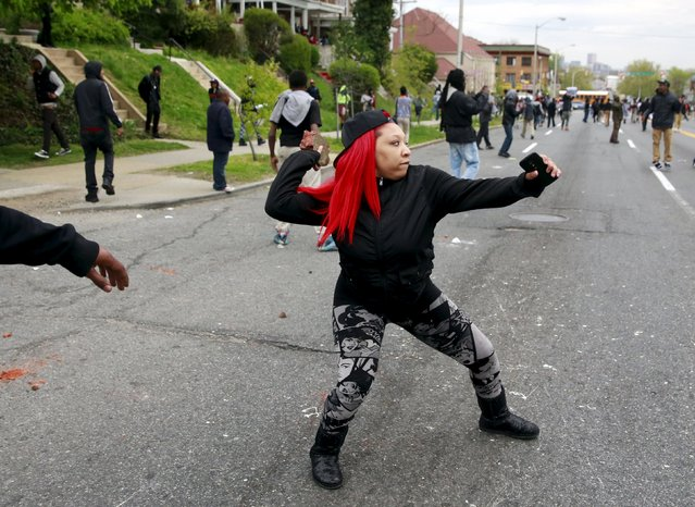 Demonstrators throw rocks at Baltimore police during clashes in Baltimore, Maryland April 27, 2015. Several Baltimore police officers were injured on Monday in violent clashes with young people after the funeral of Freddie Gray, a black man who died in police custody, and local law enforcement warned of a threat by gangs. (Photo by Shannon Stapleton/Reuters)