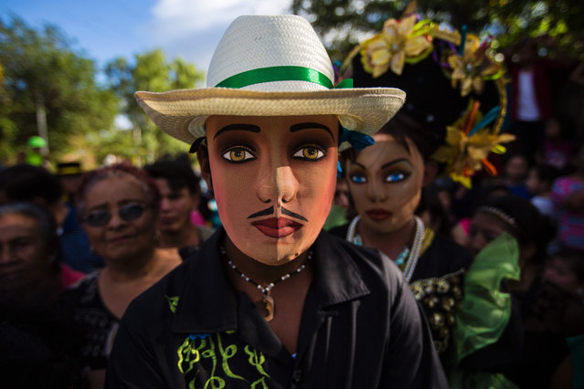 "A man dressed as a traditional character in the ""Baile de Negras"" dance poses for a picture on the feast day of the Virgin of the Candelaria (Candlemas) in the town of Diriomo, some 45 km from Managua, Nicaragua on February 2, 2017 Candlemas falls forty days after Christmas and is celebrated by Catholics as the presentation of Christ at the Temple. (Photo by Inti Ocon/AFP Photo)"