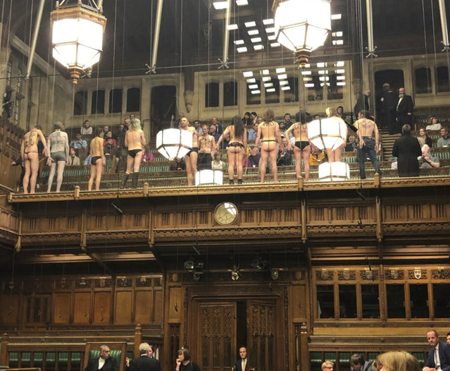 In this photo made available from the Twitter page of James Heappey MP, demonstrators protest in the public gallery in the House of Commons, London, Monday April 1, 2019. A dozen demonstrators have been arrested after stripping off in Britain's House of Commons to protest climate change. (Photo by James Heappey via AP)