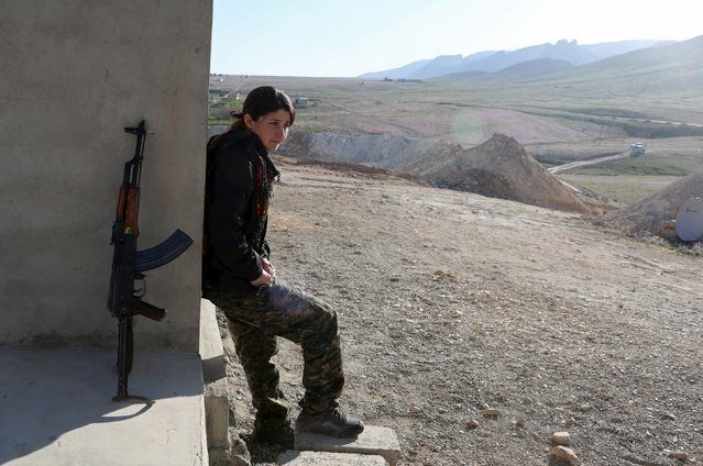 A female Kurdistan Workers Party (PKK) fighter stands outside a base in Sinjar, March 11, 2015. (Photo by Asmaa Waguih/Reuters)