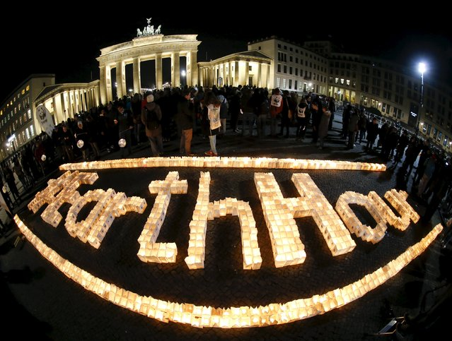 The Brandenburger Tor gate is seen before the Earth Hour in Berlin, Germany March 19, 2016. (Photo by Fabrizio Bensch/Reuters)