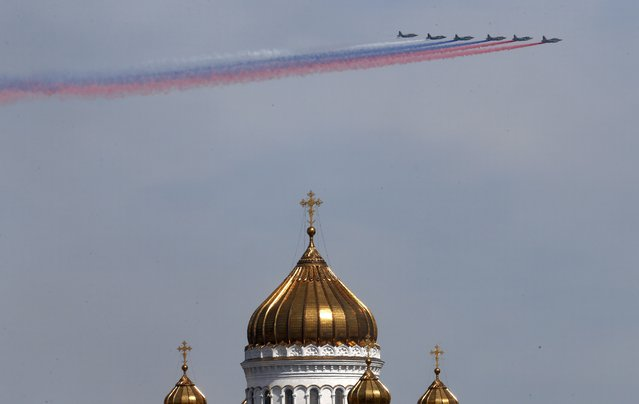SU-25 military jets fly in formation during the Victory Day parade, with the Christ the Saviour Cathedral seen in the foreground, in Moscow, Russia, May 9, 2015. (Photo by Maxim Zmeyev/Reuters)