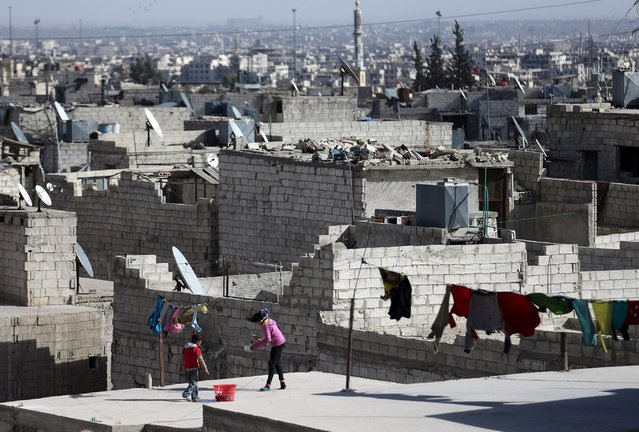 Children stand on a rooftop in the rebel-held Tishreen neighborhood of Damascus, Syria March 14, 2016. (Photo by Bassam Khabieh/Reuters)
