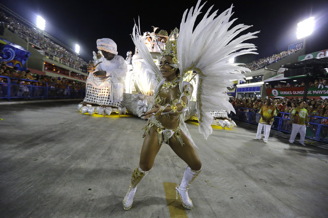 A performer from the Imperio da Tijuca samba school parades during carnival celebrations at the Sambadrome in Rio de Janeiro, Brazil, Sunday, March 2, 2014. (Photo by Nelson Antoine/AP Photo)
