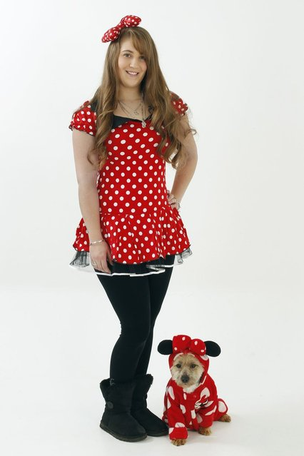 Emmie and Muffin the Jackadoodle wearing matching Minnie Mouse outfits. (Photo by Helen Yates/Barcroft Media)