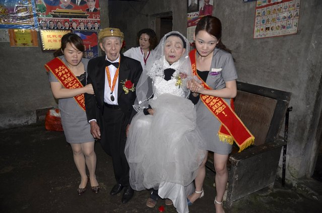 Yan Zhengming (2nd L), 94, and his wife Zhou Suqing (2nd R), 90, are helped by volunteers to attend their wedding ceremony at their home, on the 70th anniversary of their marriage, in Quxian county of Dazhou, Sichuan province, China, May 15, 2015. (Photo by Reuters/Stringer)