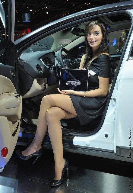 A model presents a Lancia Delta car