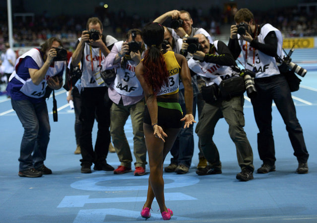 Jamaica's Shelly-Ann Fraser-Pryce poses for photographers after winning the women's 60m final in the world indoor athletics championships at the ERGO Arena in Sopot March 9, 2014. (Photo by Dylan Martinez/Reuters)