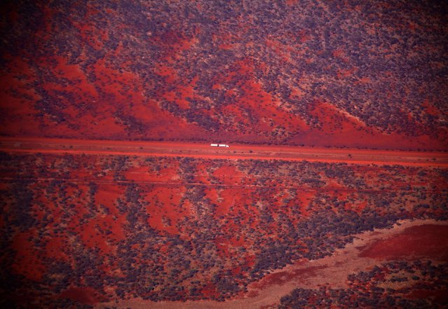 A truck drives along a road in the Pilbara region of Western Australia December 2, 2013. (Photo by David Gray/Reuters)