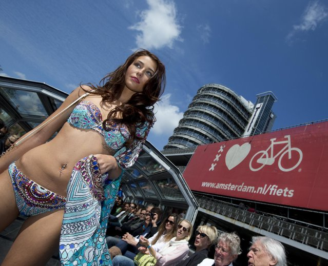 A model sports beachwear designed by Gottex during the Canal Catwalk fashion show with clothing dedicated to Kate, Duchess of Cambridge, during the first edition of the World Fashion Fair in Amsterdam, Netherlands, Thursday, May 21, 2015. (Photo by Peter Dejong/AP Photo)