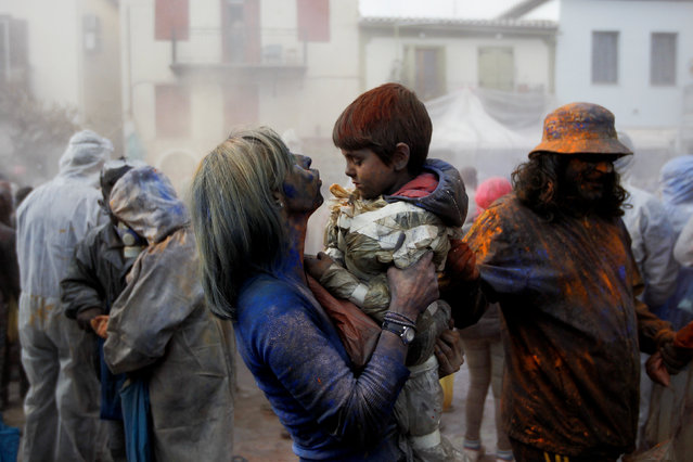 """A woman blows into a boy's eyes to remove flour as revellers celebrate """"Ash Monday"""" by participating in a colourful """"flour war"""", a traditional festivity marking the end of the carnival season and the start of the 40-day Lent period until the Orthodox Easter,in the port town of Galaxidi, Greece, February 27, 2017. (Photo by Alkis Konstantinidis/Reuters)"""