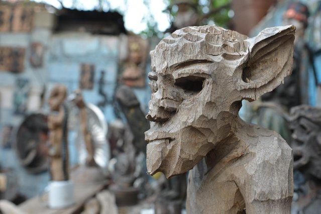 In this April 4, 2016 photo a carved wooden sculpture is displayed inside an open-air museum and art workshop off a trash-strewn street cutting through some of the poorest neighborhoods in Port-au-Prince, Haiti. (Photo by David McFadden/AP Photo)