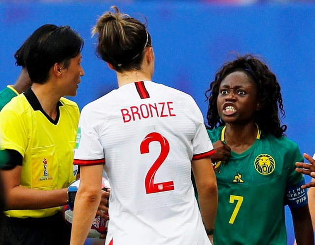 Cameroon's Gabrielle Aboudi Onguene reacts at England's Lucy Bronze as referee Qin Liang looks on during the Women's World Cup round of 16 match at Stade du Hainaut in Valenciennes, France, June 23, 2019. (Photo by Phil Noble/Reuters)