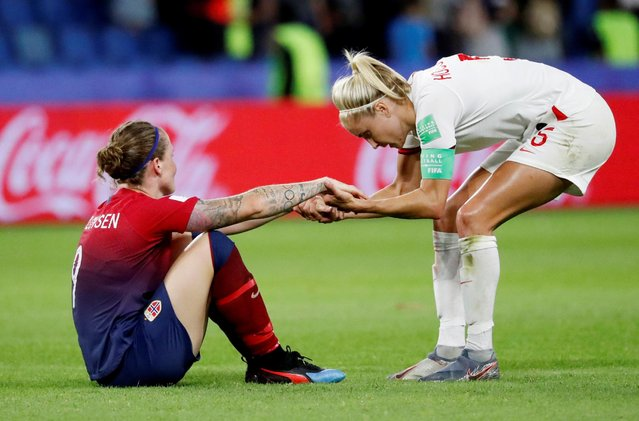 Steph Houghton of England comforting Isabell Herlovsen of Norway after Norway's out of the tournament during the 2019 FIFA Women's World Cup France Quarter Final match between Norway and England at Stade Oceane on June 27, 2019 in Le Havre, France. (Photo by Bernadett Szabo/Reuters)