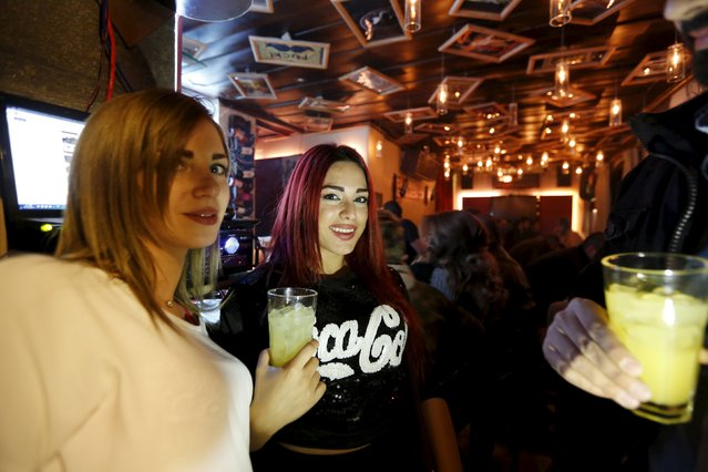 People carry drinks at 80s Bar in Damascus, Syria, March 11, 2016. (Photo by Omar Sanadiki/Reuters)