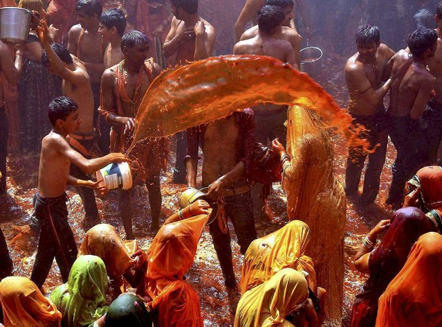 Mathura : Devotees playing Huranga at Dauji temple near Mathura on Tuesday, March 14, 2017, a day after Holi in which women tear the shirts of men. (Photo by Press Trust of India)