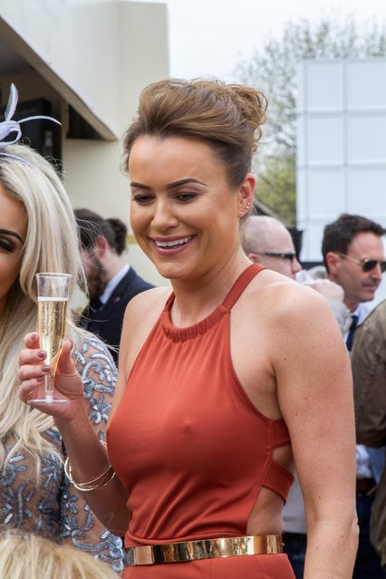 A brunette and her pals were spotted enjoying a glass of bubbly while cheering on the jockeys during the Grand National Festival at Aintree Racecourse on April 7, 2017 in Liverpool, England. (Photo by Alamy Stock Photos)