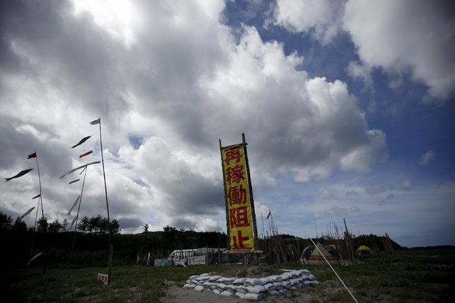 """A banner (C) reading """"Stop Restart"""" is displayed at a protesters' camp site near Kyushu Electric Power's Sendai nuclear power station in Satsumasendai, Kagoshima prefecture, Japan, July 8, 2015. (Photo by Issei Kato/Reuters)"""