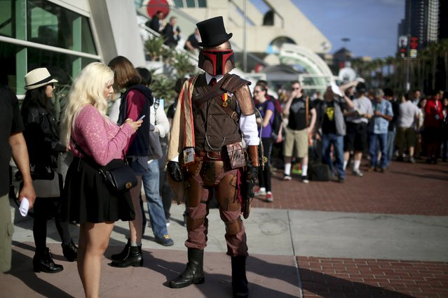 A man dressed as a Storm Trooper stands outside of the Convention Center during the 2015 Comic-Con International in San Diego, California, July 9, 2015. (Photo by Sandy Huffaker/Reuters)