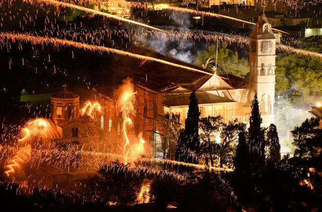 """The Panaghia Erithiani Church is hit by rockets from supporters of the Aghios Marko Church during the annual Rocket War, known locally as the """"Rouketopolemos"""", on April 15, 2017 in Chios, Greece. (Photo by Leon Neal/Getty Images)"""