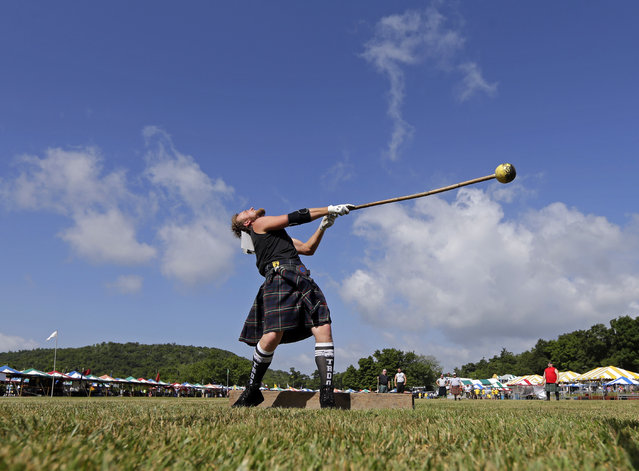 Adam Patterson, of Brevard, N.C., prepares to throw the hammer during the 59th annual Grandfather Mountain Highland Games in Linville, N.C., Friday, July 10, 2015. (Photo by Chuck Burton/AP Photo)